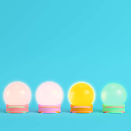 Four colorful crystal glass on bright blue background in pastel colors. Minimalism concept. 3d render Фото со стока