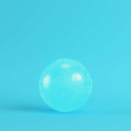 Pink crystal ball on bright blue background in pastel colors. Minimalism concept. 3d render Фото со стока