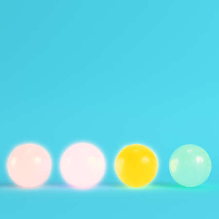 Four colorful crystal balls on bright blue background in pastel colors. Minimalism concept. 3d render