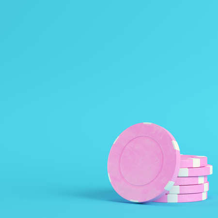 Pink casino chips on bright blue background in pastel colors. Minimalism concept. 3d render