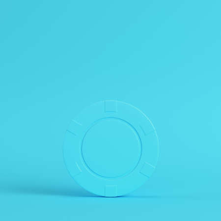 Casino chip on bright blue background in pastel colors. Minimalism concept. 3d render Фото со стока