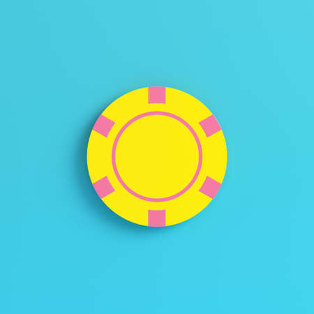 Yellow casino chip on bright blue background in pastel colors. Minimalism concept. 3d render Фото со стока