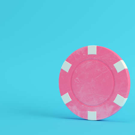 Pink casino chip on bright blue background in pastel colors. Minimalism concept. 3d render