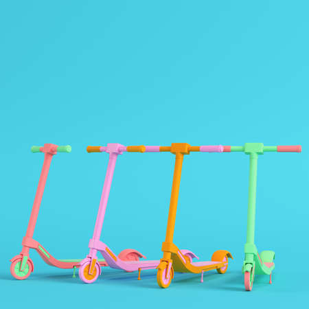 Four colorful kick scooters on bright blue background in pastel colors. Minimalism concept. 3d render Фото со стока