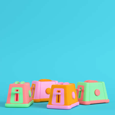 Four colorful toasters on bright blue background in pastel colors. Minimalism concept. 3d render Фото со стока