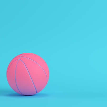 Pink basketball ball on bright blue background in pastel colors. Minimalism concept. 3d render