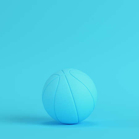 Basketball ball on bright blue background in pastel colors. Minimalism concept. 3d render Zdjęcie Seryjne