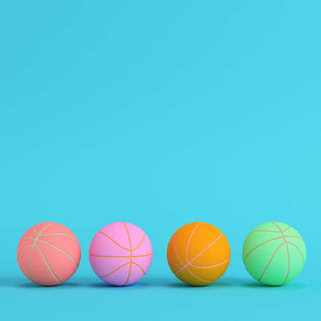 Four basketball balls on bright blue background in pastel colors. Minimalism concept. 3d render Zdjęcie Seryjne