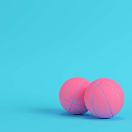 Pink basketball balls on bright blue background in pastel colors. Minimalism concept. 3d render