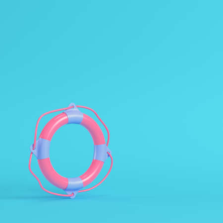 Pink life buoy on bright blue background in pastel colors. Minimalism concept. 3d render