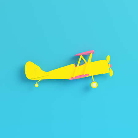 Yellow biplane on bright blue background in pastel colors. Minimalism concept. 3d render
