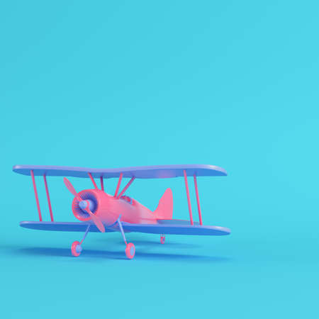 Pink biplane on bright blue background in pastel colors. Minimalism concept. 3d render