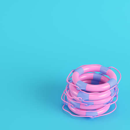 Pink stack life buoys on bright blue background in pastel colors. Minimalism concept. 3d render