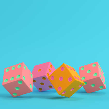 Four colorful dices on bright blue background in pastel colors. Minimalism concept. 3d render