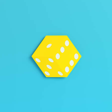 Yellow dice on bright blue background in pastel colors. Minimalism concept. 3d render Zdjęcie Seryjne