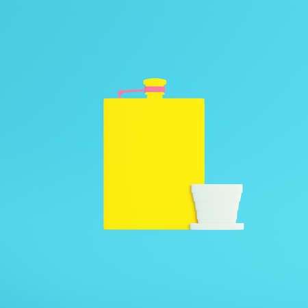 Yellow hip flask with cup on bright blue background in pastel colors. Minimalism concept. 3d render