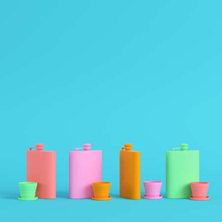 Four hip flasks with cup on bright blue background in pastel colors. Minimalism concept. 3d render