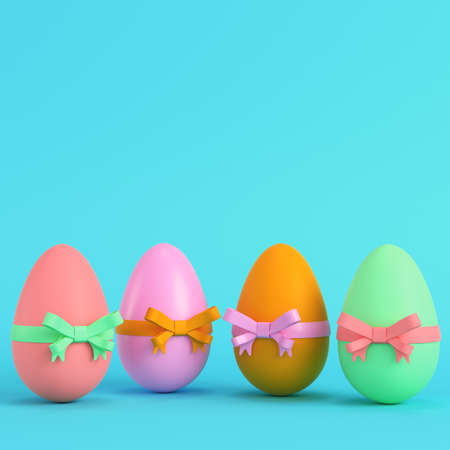 Colorful easter eggs with bow on bright blue background in pastel colors. Minimalism concept. 3d render