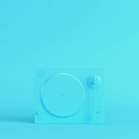 Yellow turntable on bright blue background in pastel colors. Minimalism concept. 3d render