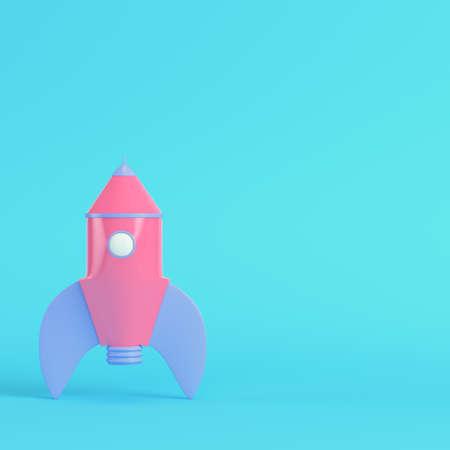 Pink cartoon styled rocket on bright blue background in pastel colors. Minimalism concept. 3d render Standard-Bild