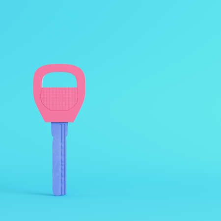 Yellow two keys on keyring on bright blue background in pastel colors. Minimalism concept. 3d render Standard-Bild