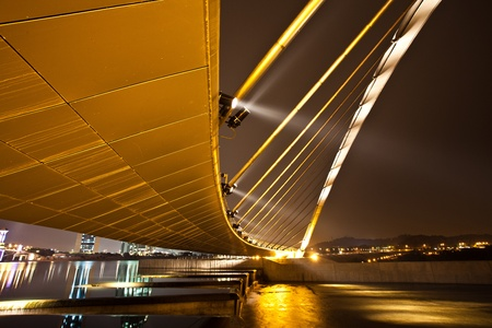 A bridge over a dam in Putrajaya, Malaysia at night. photo
