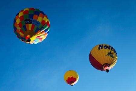 oex: Chateau d Oex, Switzerland - January 23, 2011: Annual International Hot Air Balloon Festival Editorial