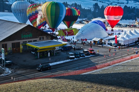 oex: Chateau d Oex, Switzerland - January 23, 2011: Annual International Hot Air Balloon Festival Editorial