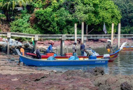 August 3 2011, Tanjung Dawai, Kedah, Malaysia. Malaysian fisherman returningn home from a morning at sea.