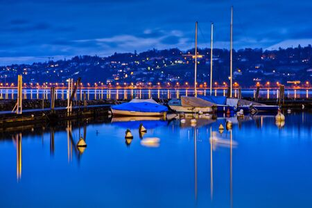 Boats mooring at a marina in Geneva, Switzerland photo