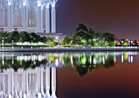 front elevation: Tuanku Mizan or commonly known as The Iron Mosque front elevation with reflection on the lake surface. Stock Photo