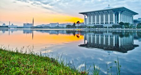 Tuanku Mizan or commonly known as The Iron Mosque in Putrajaya, Malaysia with its reflection on the lake surface in the morning hours photo