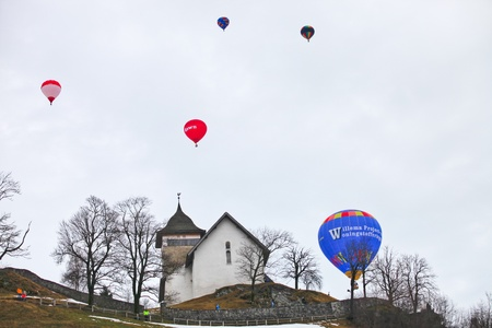 oex: January 23rd, 2012 Chateau de Oex, Switzerland. The 34th International Hot Air Balloon Festival in Chateau de Oex Switzerland. The festival is being held from 21- 29 January 2012.