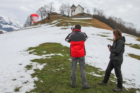 oex: January 23rd, 2012 Chateau de Oex, Switzerland. Hot air balloons at the 34th International Hot Air Balloon Festival in Chateau de Oex Switzerland. The festival is being held from 21- 29 January 2012.  Editorial