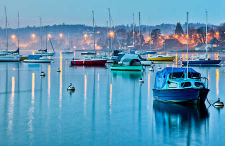 Sailboats moored in a small bay at Lake Geneva, Switzerland,