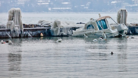 Sinking frozen Boats at Lake Geneva, Switzerland in February 2012, the unusual extreme cold temperature across Europe. photo