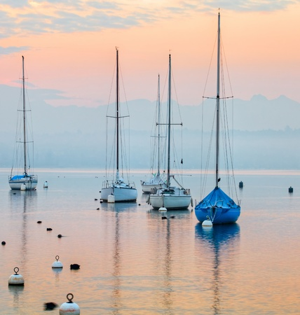 Sunrise at Lake Geneva, Switzerland with sailboats and yachts