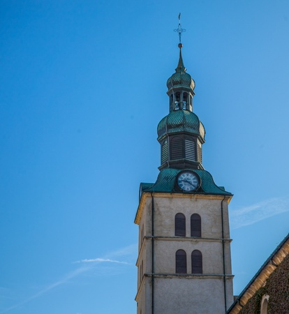 Saint Jean Baptiste church tower in Megeve, France photo