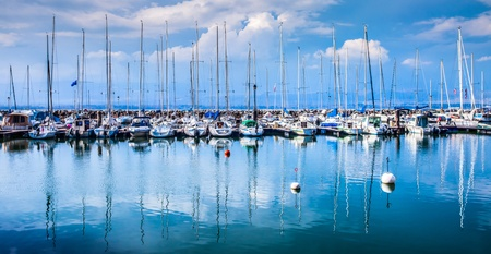 Boats and small yachts moored at a marina in Yvoire, France