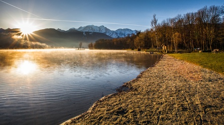 Mont Blanc Massif in the early morning sunrise captured from the edge of Lac du Passy, Passy, France  Located in the Arve Valley, France, between Geneva, Switzerland and Chamonix, Mont Blanc  photo
