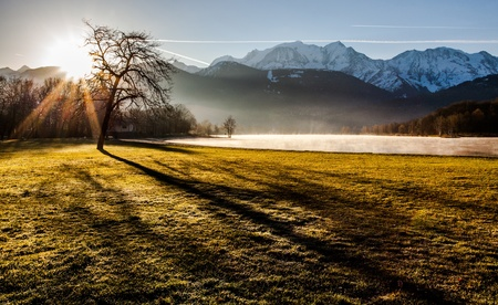 Mont Blanc Massif in the early morning sunrise captured from the edge of Lac du Passy, Passy, France  Located in the Arve Valley, France, between Geneva, Switzerland and Chamonix, Mont Blanc
