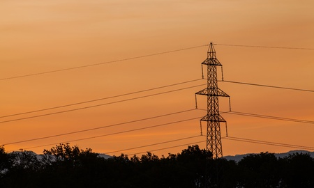 Power line silhouette at rising sun photo