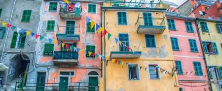 Colored buildings at Riomaggiore, one of the five famous fishing village and tourist destination in Cinque Terre, Italy