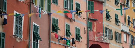 Colored buildings at Riomaggiore, one of the five famous fishing village and tourist destination in Cinque Terre, Italy  photo
