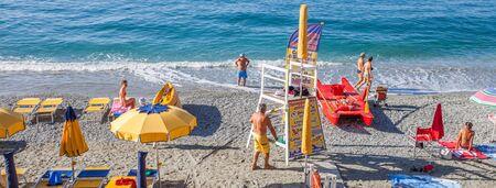 monterosso: Monterosso, Cinque Terre, Italy. August 8, 2012. Mediterranean beach scene during summer.