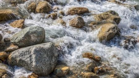 aosta: The alpine mountain stream of Dora di Ferret at Val Veny, Italy