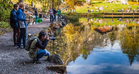 Blausee, Switzerland, October 6th, 2012. Anglers enjoying the autumn trouts fishing at the Blausee lake.  Stock Photo - 15723908