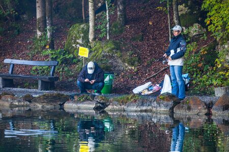 Blausee, Switzerland, October 6th, 2012. Anglers enjoying the autumn trouts fishing at the Blausee lake.  Stock Photo - 15723925