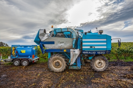 deployed: Satigny, Geneva, Switzerland, October 14th, 2012.  Braud grape harvester waiting to be deployed to harvest grapes in the vineyards. Editorial