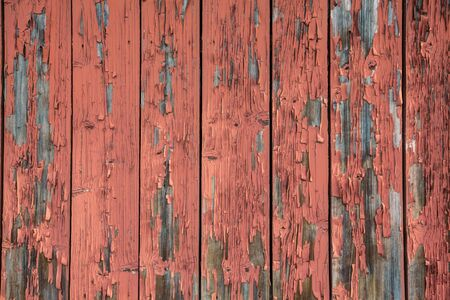 peeled off: Old, peeled off red paint on a wooden wall for abstract and background